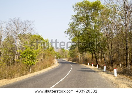 Curved road in Tay Nguyen highland of Vietnam - stock photo
