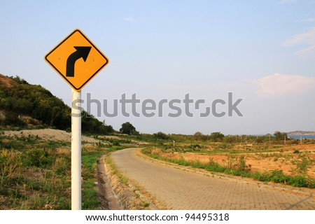 Curved Road Traffic Sign - stock photo