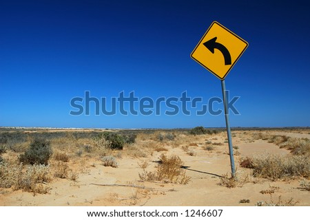 Curved Road Traffic Sign on a Rural Road - stock photo