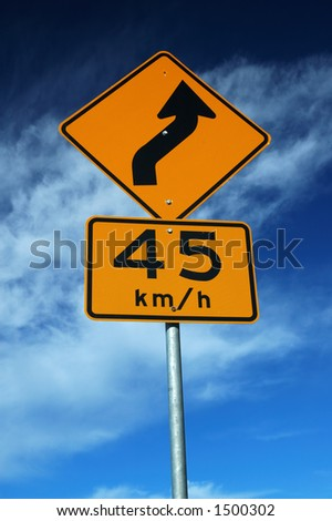 Curved Road Traffic Sign over Blue Sky - stock photo