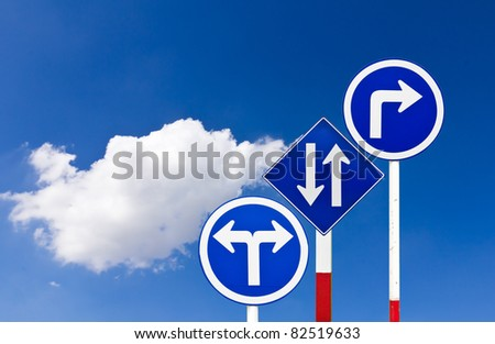 Curved Road Traffic Sign over blue sky,turn right - stock photo