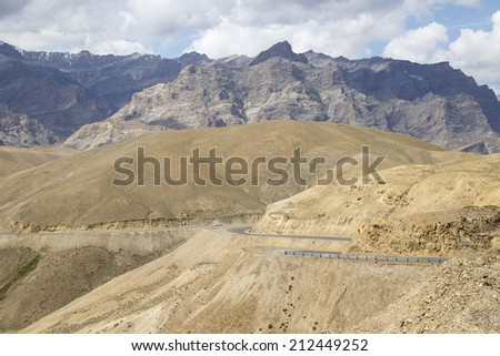 Curved Road with Mountain Background in Leh - Ladakh, North of India - stock photo