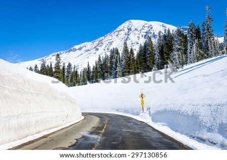Curved Snowy Road at Mount Rainier National Park - stock photo