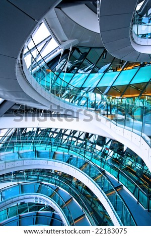 Curved staircase in big glass office building - stock photo