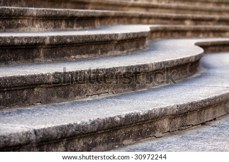 curved steps leading up to a cathedral - stock photo
