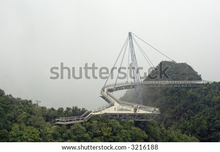Curved suspension bridge in Geopark, Langkawi Island, Malaysia. - stock photo