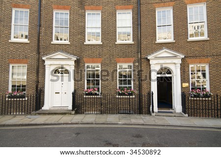 Curved terraced home apartments and offices in London,England - stock photo