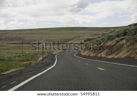 Curves in the road in the back country of palouse. - stock photo