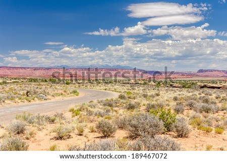 Curving Gravel Road in a Desert Landscape  - stock photo