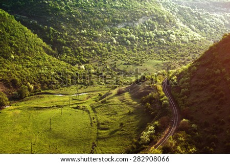 Curving Railway Track through a summer Forest. - stock photo