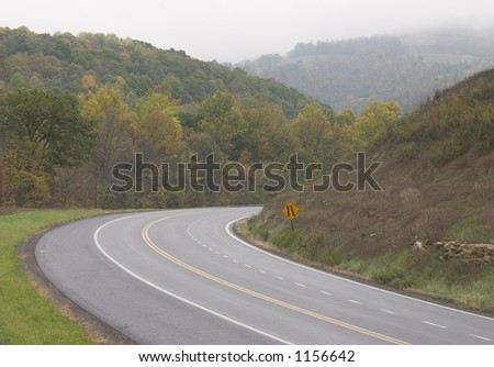 Curvy mountain road. - stock photo