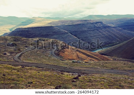 Curvy road in mountains. Shot in Lesotho. - stock photo