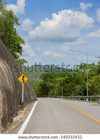 Curvy road sign on a country road ,Thailand - stock photo