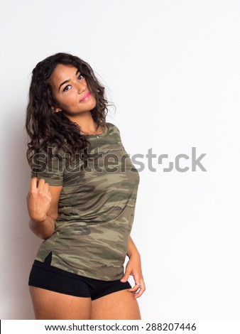 Curvy young woman with curly hair and olive skin - stock photo