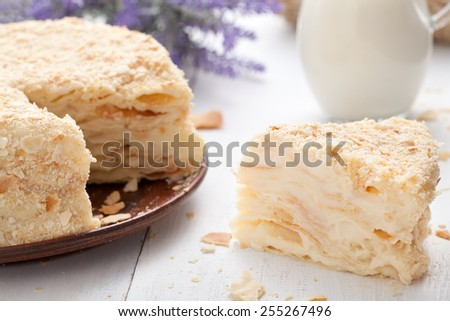 Custard slice cake in vintage provence style background with milk, eggs and lavender - stock photo