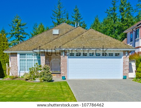 Custom built big luxury house in a residential neighborhood. Suburbs of Vancouver ( Surrey ) Canada. - stock photo