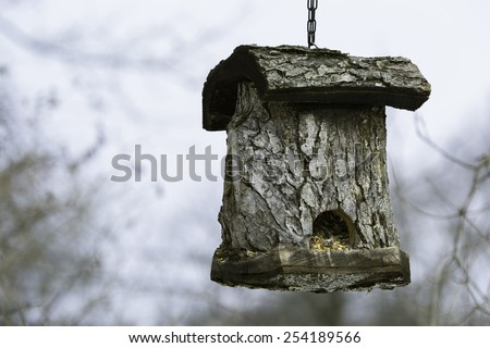 Custom built bird house on blurred winter background. with unique style, hand crafted birdhouse - stock photo