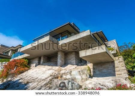 Custom built luxury modern house on the cliff, rock  in a residential neighborhood. Vancouver Canada. - stock photo
