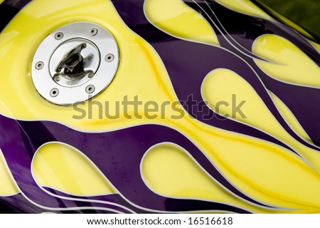 custom flames on motorcycle gas tank - stock photo