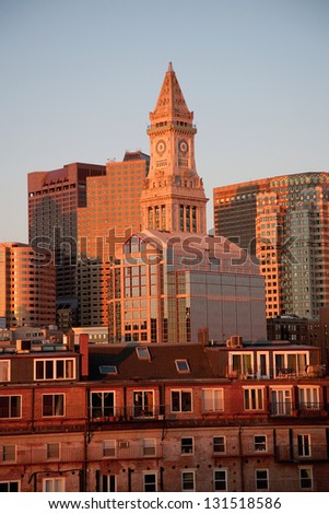 Custom House Tower and Boston Skyline with condos below it at sunrise in Boston, MA - stock photo