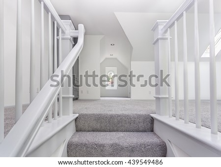 Custom stairs and railings are now carpeted and painted - stock photo
