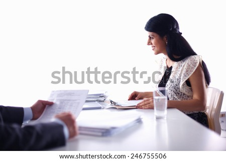 Customer and agent sitting at desk in a meeting or successful collaboration under businesspeople on  office - stock photo