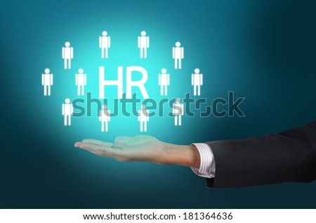 Customer care, care for employees, labor union, CRM, and life insurance concepts. Businessman holding manpower in corporate cloud concept - stock photo