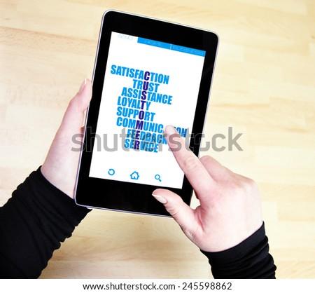 Customer crossword concept written on tablet pc - stock photo