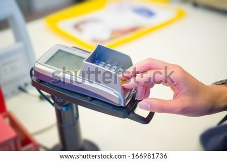 Customer enter code at credit card payment terminal - stock photo