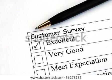 Customer fills in the feedback survey - stock photo