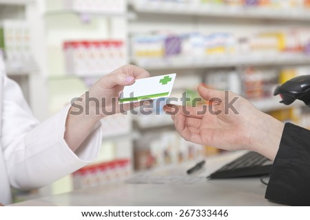 Customer hands over her payment customer card - stock photo