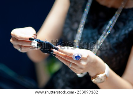 customer looking at fine jewellery - stock photo