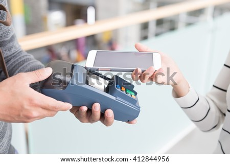 Customer pay by cellphone with empty screen, great for your design - stock photo