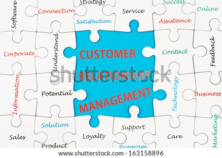 Customer relationship management concept word cloud on group of jigsaw puzzle pieces - stock photo