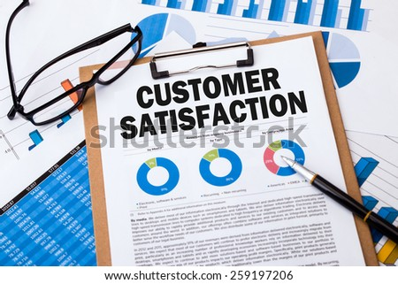 customer satisfaction analysis report on clipboard - stock photo