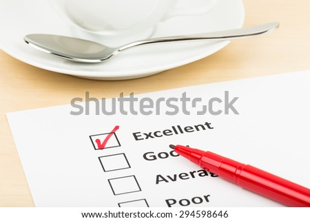 Customer satisfaction survey checkbox with excellent tick - stock photo