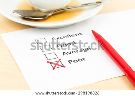 Customer satisfaction survey checkbox with poor tick - stock photo