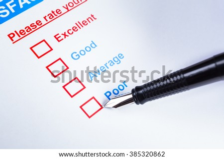 Customer satisfaction survey checkbox with rating and pen pointing at Poor, can use any business concept background - stock photo