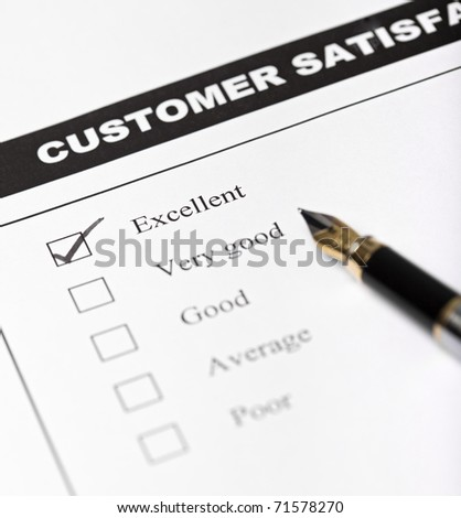 Customer satisfaction survey form with pen - closeup with focus on the checked excellent checkbox - stock photo