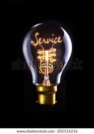 Customer Service concept in a filament lightbulb. - stock photo