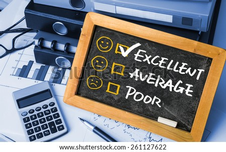 customer service evaluation concept on blackboard - stock photo
