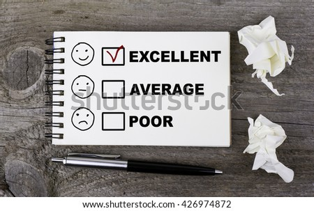 Customer service evaluation concept. Text on a note pad on a wooden table.  - stock photo