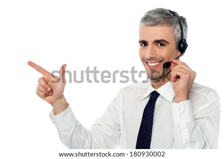 Customer service executive pointing at something - stock photo