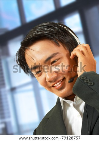 Customer Service Helpdesk Operator Talking To A Customer And Wearing A Headset - stock photo