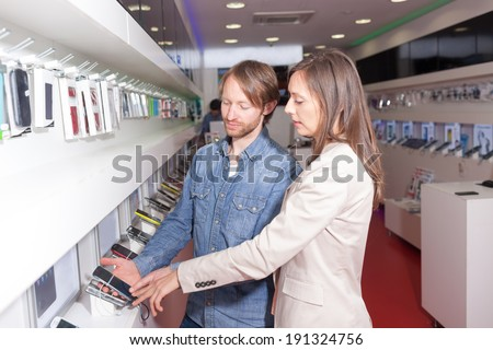Customer service in phone shop  - stock photo