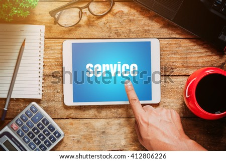 customer service online, On tablet in a desk. - stock photo