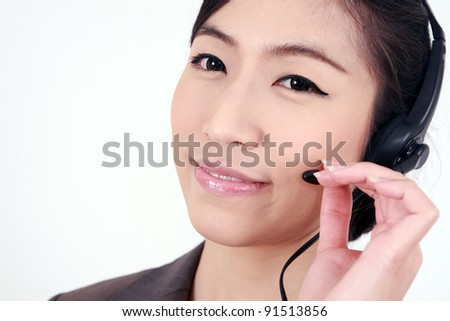 Customer service operator woman with headset smiling - stock photo
