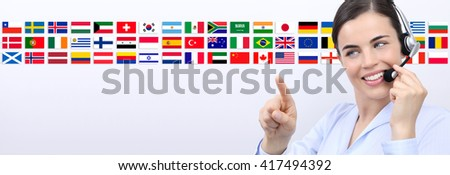 customer service operator woman with headset smiling and pointing flags background - stock photo