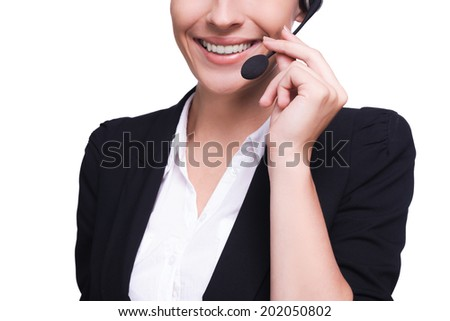 Customer service representative. Cropped image of beautiful young woman in headset smiling while isolated on white - stock photo