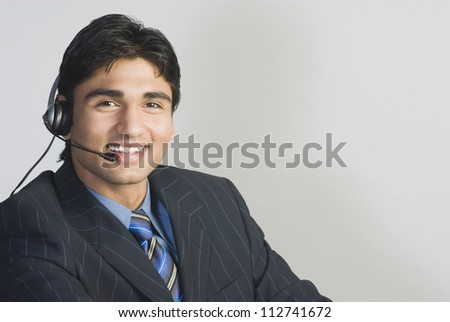 Customer service representative wearing a headset